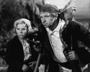 "Jackie Cooper, as Jim Hawkins, hangs out with his buddy Wallace Beery, as Long John Silver, in ""Treasure Island."""