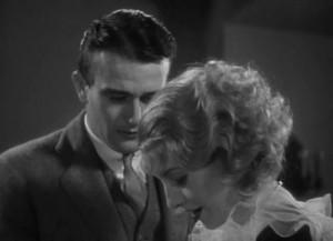 "John Wayne desires Barbara Stanwyck in ""Baby Face."""