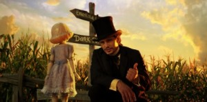 """James Franco, as Oz, talks to China Girl on the yellow brick road in """"Oz the Great and Powerful.""""  (Photo courtesy Walt Disney Pictures)"""