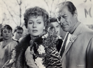 "Rita Hayworth and Rex Harrison in ""The Happy Thieves."""