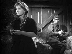 "Zhanna Prokhorenko (as Shura) meets Vladimir Ivashov (as Alyosha) in a railroad car in ""Ballad of a Soldier."""