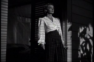 "Bette Davis comes out of her bungalow in ""The Letter."""