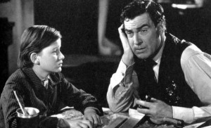 "Roddy McDowall (as Huw Morgan) discusses life with Walter Pidgeon (as Mr. Gruffydd) in ""How Green Was My Valley."""