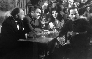"Edward G. Robinson, Rod Steiger, Joan Collins and Eli Wallach plan a casino heist in ""Seven Thieves."""