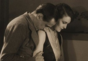 """Miles Mander comforts Madeleine Carroll in """"The First Born."""""""