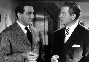 "Lino Ventura (left) faces off against Jean Gabin in ""Touchez pas au grisbi."""
