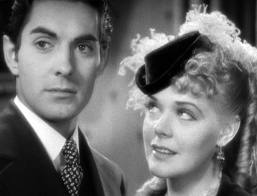 "Alice Faye looks at Tyrone Power in ""In Old Chicago."""