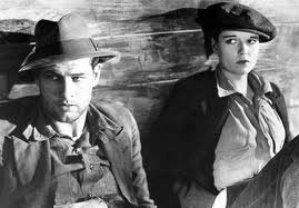 "Richard Arlen and Louise Brooks ride the rails in ""Beggars of Life."""