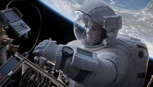 "Sandra Bullock, as Ryan Stone, works on the space shuttle in ""Gravity."""