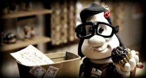 "Mary makes a package for Max in ""Mary and Max."""