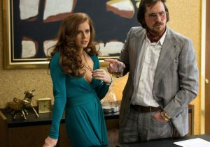"Amy Adams as Sidney Prosser and Christian Bale as Irving Rosenfeld in ""American Hustle."""