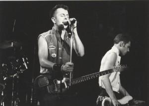Joe Strummer, performing in The Clash.