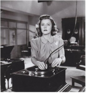 """Irene Dunne works in a record store in """"Penny Serenade."""""""