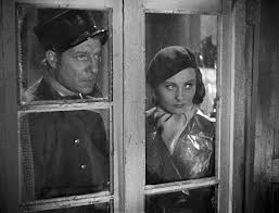 "Jean Gabin and Michèle Morgan are on the lookout in ""Port of Shadows."""