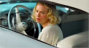 "Renée Zellweger behind the wheel of a blue Cadillac in ""My One and Only."""
