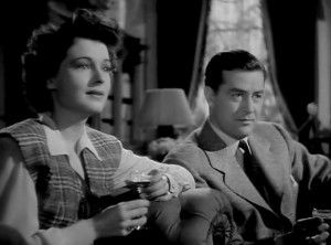 "Ruth Hussey and Ray Milland deal with ghosts in ""The Uninvited."""