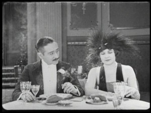 "Adolphe Menjou as Pierre and Edna Purviance as Marie in ""A Woman of Paris: A Drama of Fate."""