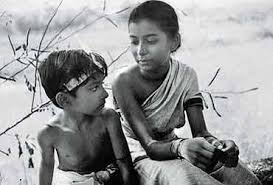 "Subir Banerjee as Apu (left) and Uma Dasgupta as Durga in ""Pather Panchali."""