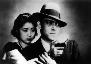 "Kinuyo Tanaka (left) and Joji Oka star in ""Dragnet Girl."""