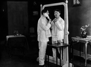 "Max Linder (left) performs the mirror gag in ""Seven Years Bad Luck."""