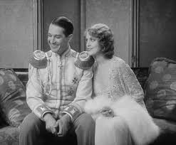 "Maurice Chevalier and Jeanette MacDonald in ""The Love Parade."""